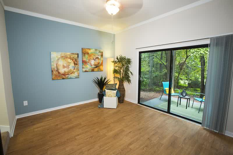 Living Room | Spacious living rooms with wood-style flooring and sliders to your own private patio/balcony.