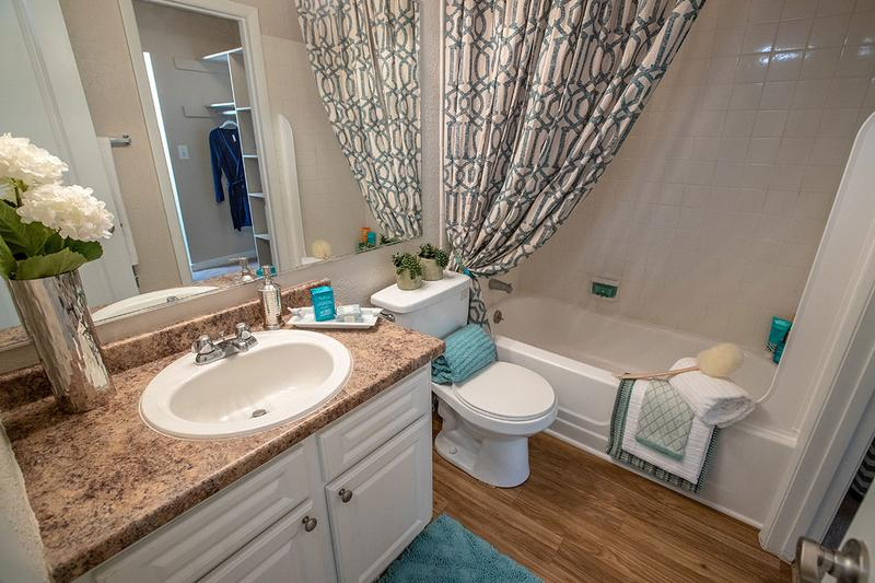 Bathroom | Newly renovated bathrooms with updated countertops and cabinetry and large mirrors.