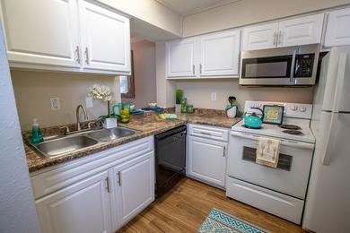 Kitchen | Kitchen of The Harbor Floor Plan, our 2 bedroom townhome with all-electric appliances.