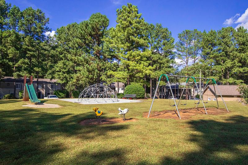 Playground | Enjoy our spacious playground area complete with 4 seat swing set, climbing dome, and slide. There is also a community garden near the playground area for residents to try out their Green Thumbs!