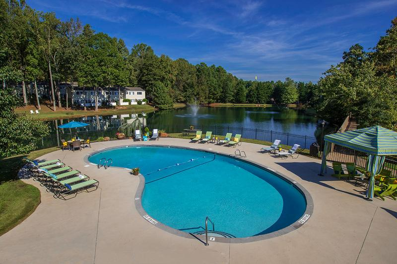 Lakeside Swimming Pool | Resort-style swimming pool and pool deck area overlooking the community's 5 acre fishing pond.