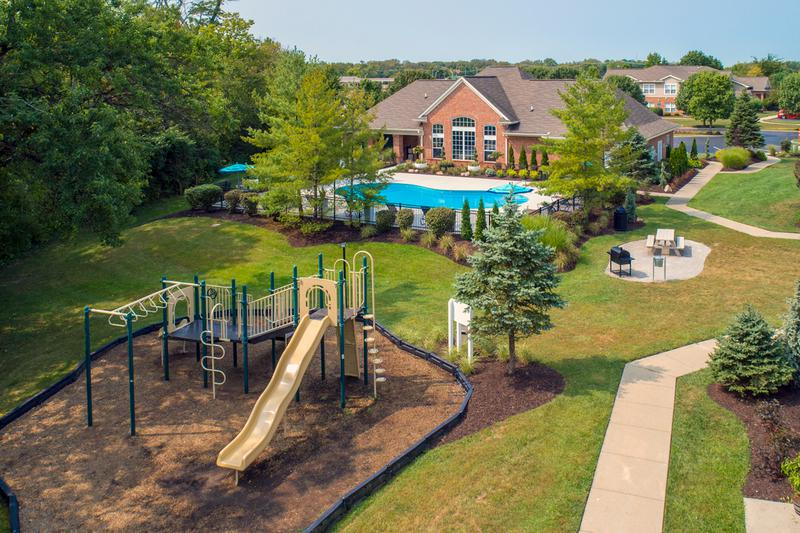 Aerial View of Amenities | At The Reserve at Monroe Crossings, you'll have access to all of our resort-style amenities including a pool, playground, and picnic area.