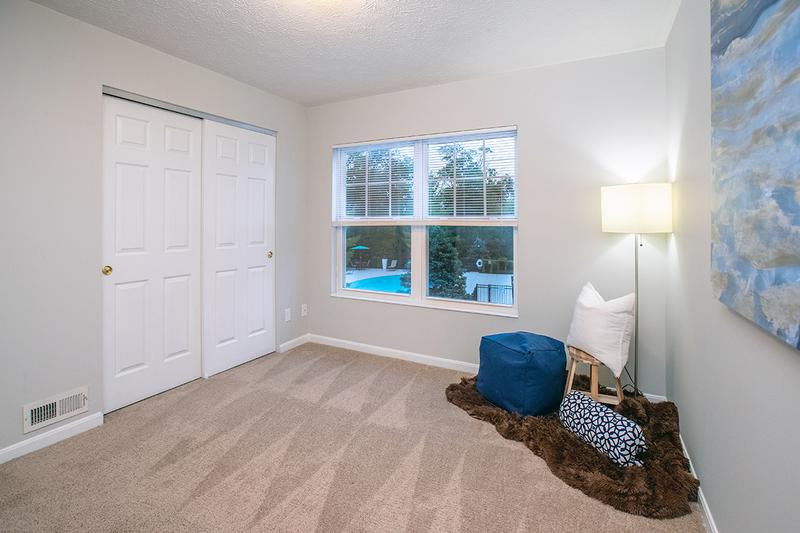 Bedroom | Spacious bedrooms featuring plush carpeting and closets with organizers.