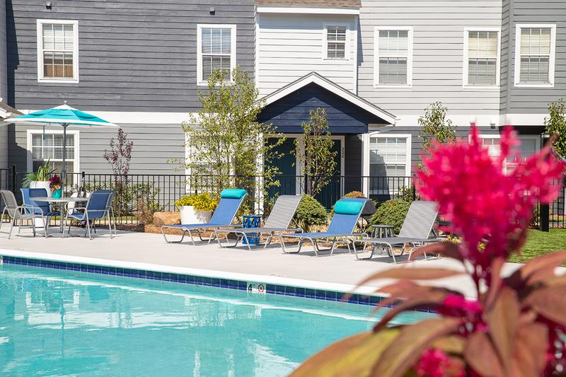 Poolside Seating | Resort style swimming pool with modern upgrades.