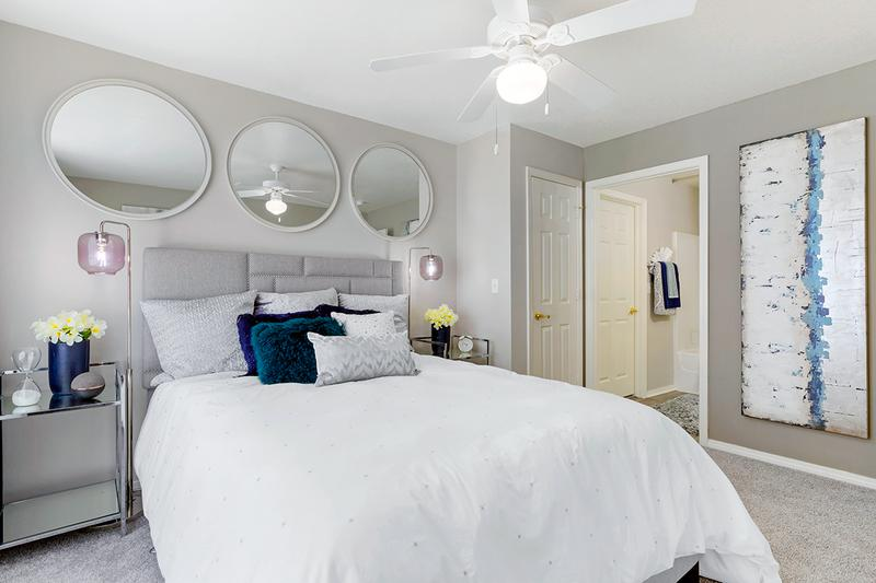Master Bedroom | Elegant master bedrooms featuring a multi-speed ceiling fan and a walk-in closet.
