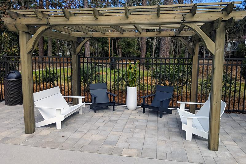 Poolside Pergola | Relax and read a book under our poolside pergola.