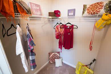 Walk-In Closets | Master bedrooms feature spacious walk-in closets with built-in organizers.