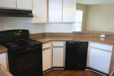 Kitchen with Breakfast Bar | You spacious kitchen features a breakfast bar that overlooks the dining and living areas.