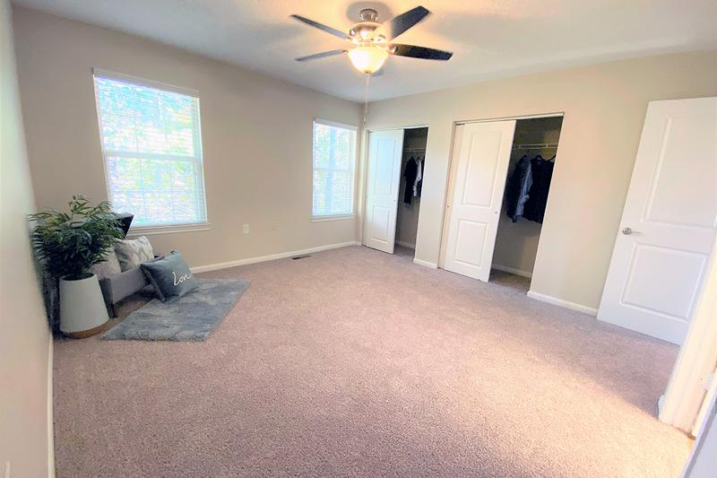 Master Bedroom | Spacious master bedrooms featuring a ceiling fan and walk-in closet.