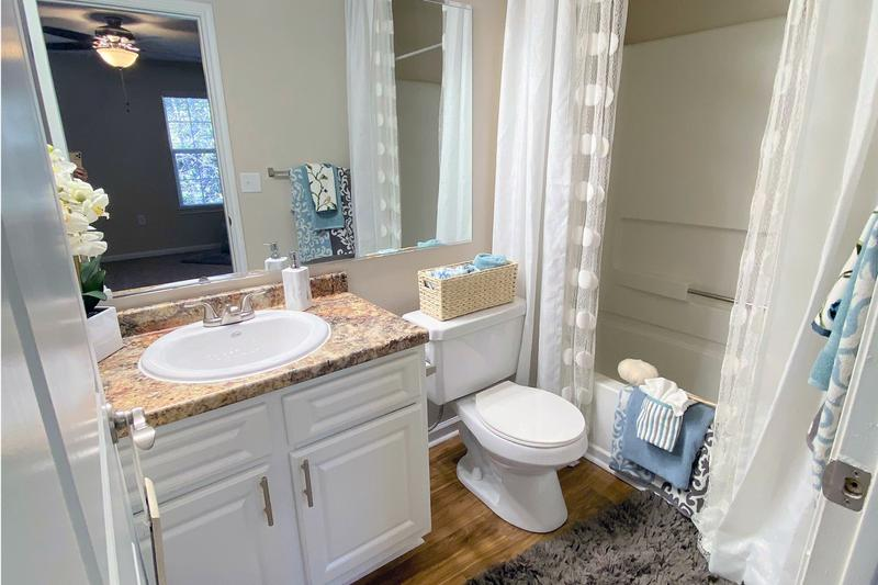 Spacious Upgraded Bathrooms | Newly remodeled bathrooms featuring granite-style counter tops and large mirrors.
