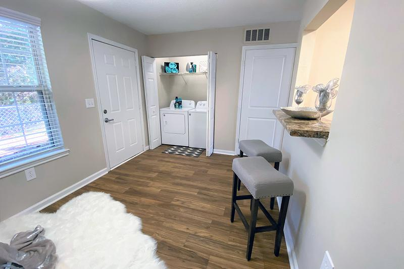 Laundry Area | Convenient in-home laundry room area provides shelving for storage as well as full sized, energy efficient washer dryers included in every home!
