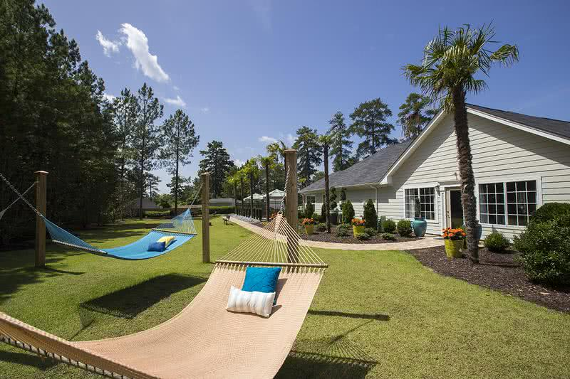 Hammock Garden with Cornhole | Soak in the sun and relax at our on-site hammock garden.