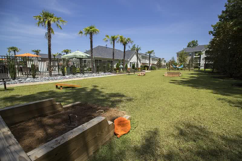 Behind Clubhouse | Behind our clubhouse, you will find our hammock garden as well as cornhole and horseshoes set up to play.