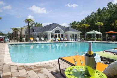 Resort-Style Swimming Pool | Resort-style pool featuring chase lounges and seating areas.
