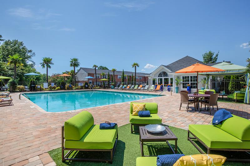 Poolside Seating | Resort-style pool featuring chaise loungers and seating areas.