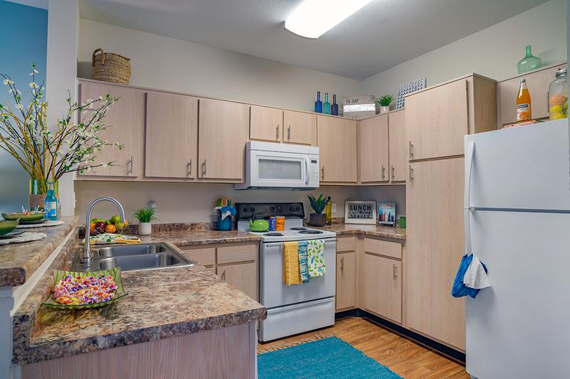 Kitchen | Newly remodeled kitchen with granite-style counter tops and all electric appliances. Includes a breakfast bar that opens up to the living room.